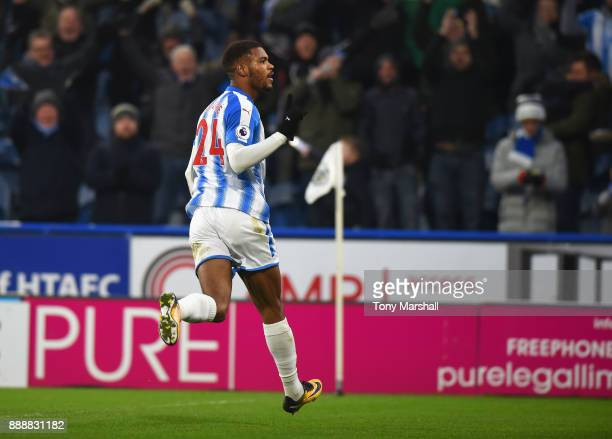 Steve Mounie of Huddersfield Town celebrates after scoring his sides second goal during the Premier League match between Huddersfield Town and...