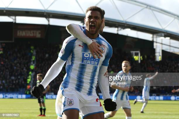 Steve Mounie of Huddersfield Town celebrates after scoring his sides second goal during the Premier League match between Huddersfield Town and AFC...