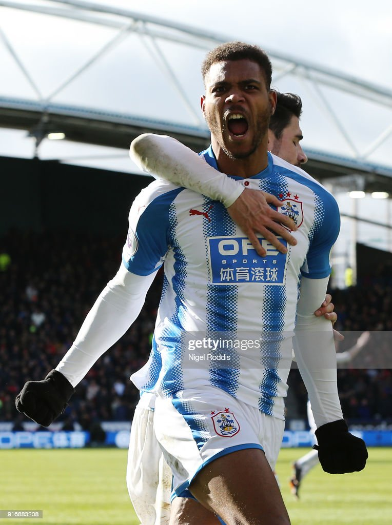 Steve Mounie of Huddersfield Town celebrates after scoring his sides second goal during the Premier League match between Huddersfield Town and AFC Bournemouth at John Smith's Stadium on February 11, 2018 in Huddersfield, England.