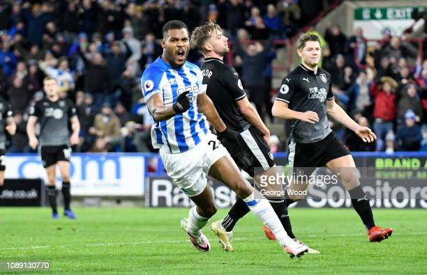 Steve Mounie of Huddersfield Town celebrates scoring his sides opening goal during the Premier League match between Huddersfield Town and Burnley FC...