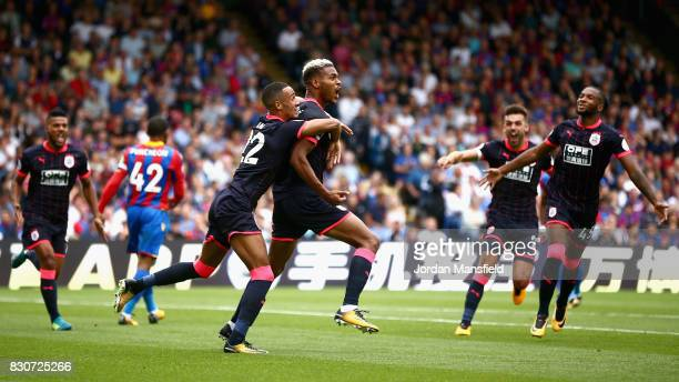 Steve Mounie of Huddersfield Town celebrates scoring his sides second goal with his Huddersield Town team mates during the Premier League match...
