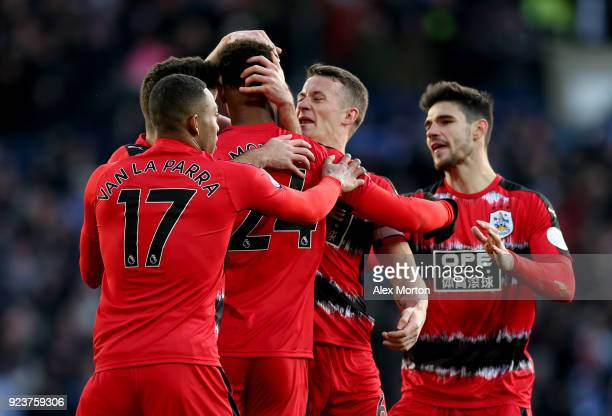 Steve Mounie of Huddersfield Town celebrates scoring his side's second goal with team mates during the Premier League match between West Bromwich...
