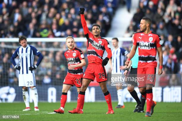 Steve Mounie of Huddersfield Town celebrates scoring his side's second goal during the Premier League match between West Bromwich Albion and...