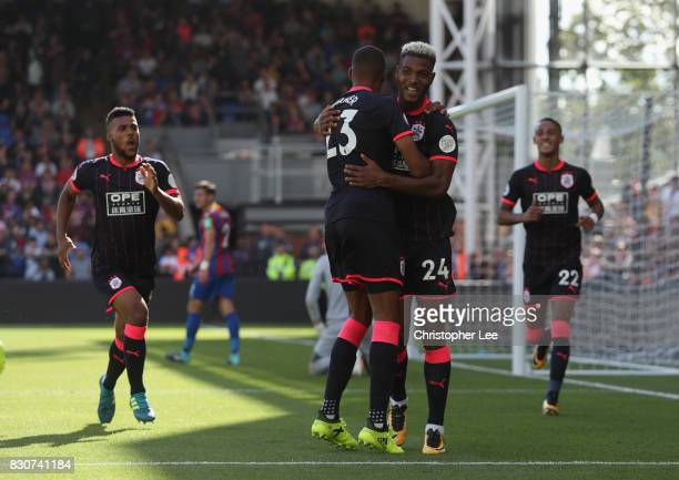 Steve Mounie of Huddersfield Town celebrates scoring his sides third goal with Collin Quaner of Huddersfield Town during the Premier League match...