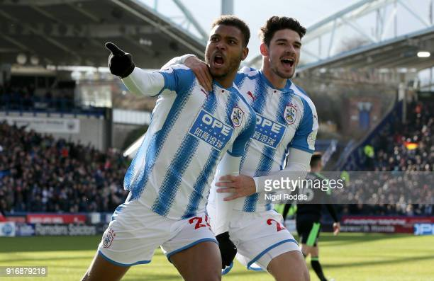 Steve Mounie of Huddersfield Town celebrates with teammate Christopher Schindler after scoring his sides second goal during the Premier League match...