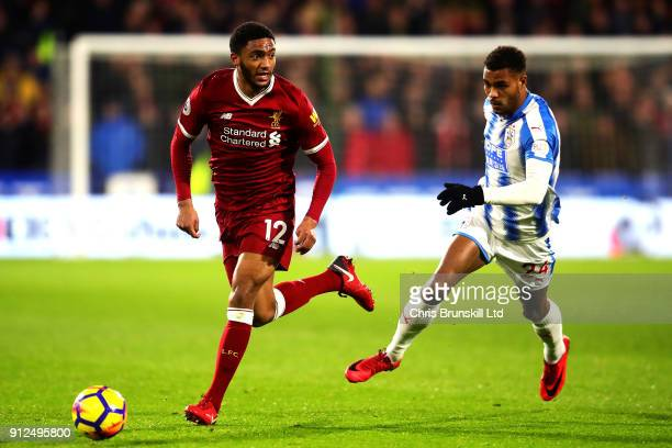 Steve Mounie of Huddersfield Town chases Joe Gomez of Liverpool during the Premier League match between Huddersfield Town and Liverpool at John...