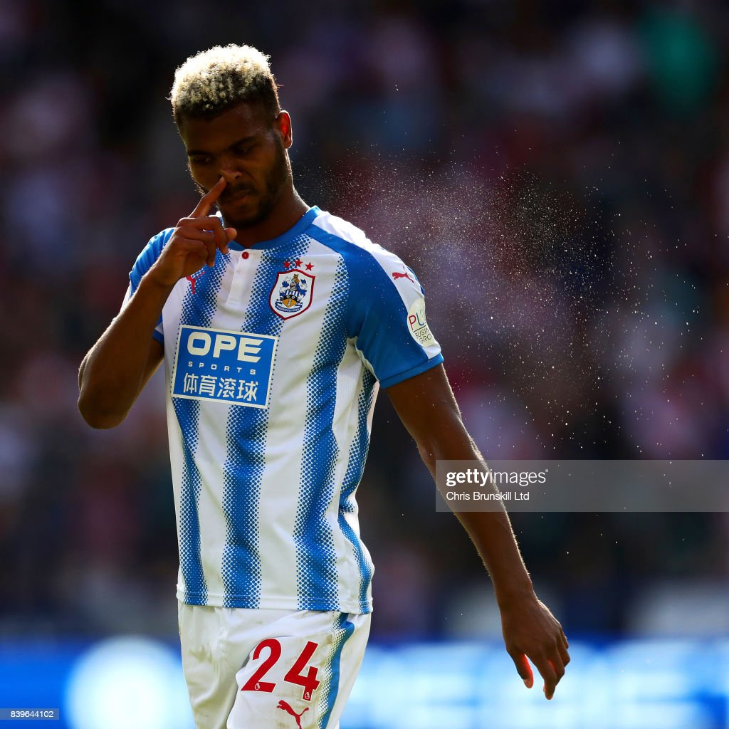 Steve Mounie of Huddersfield Town clears his nose during the Premier League match between Huddersfield Town and Southampton at the John Smith's Stadium on August 26, 2017 in Huddersfield, England.