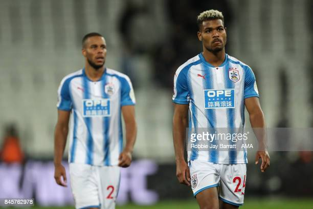 Steve Mounie of Huddersfield Town dejected at full time during the Premier League match between West Ham United and Huddersfield Town at London...