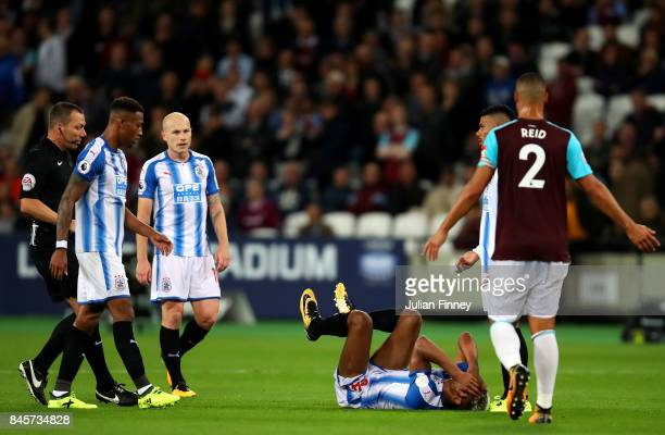 Steve Mounie of Huddersfield Town is injured during the Premier League match between West Ham United and Huddersfield Town at London Stadium on...