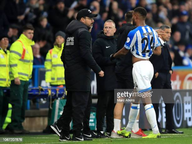Steve Mounie of Huddersfield Town leaves the pitch after recieving a red card during the Premier League match between Huddersfield Town and Brighton...