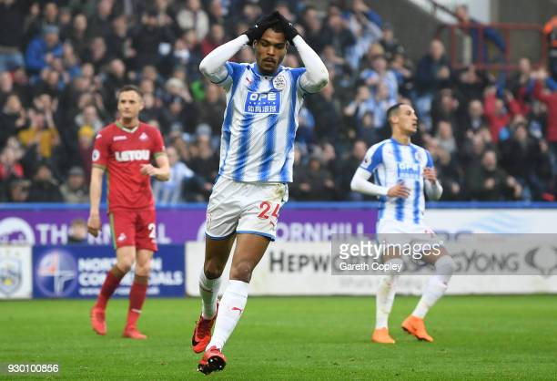 Steve Mounie of Huddersfield Town reacts following a missed chance during the Premier League match between Huddersfield Town and Swansea City at John...