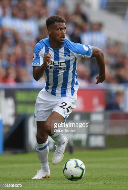 Steve Mounie of Huddersfield Town runs with the ball during the Premier League match between Huddersfield Town and Chelsea FC at John Smith's Stadium...