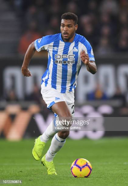 Steve Mounie of Huddersfield Town runs with the ball during the Premier League match between Wolverhampton Wanderers and Huddersfield Town at...