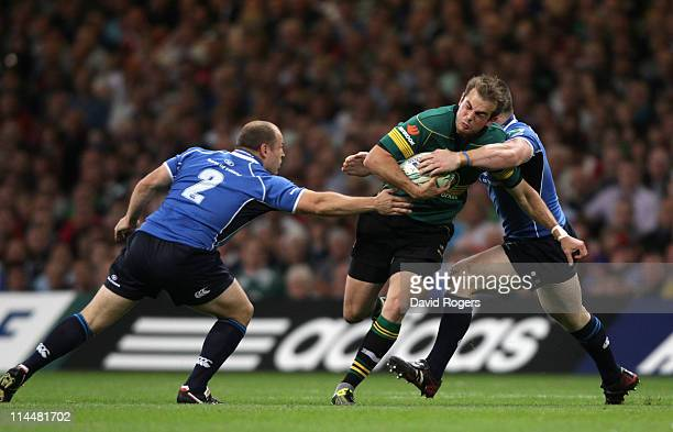 Steve Myler of Northampton is tackled by Cian Healey of Leinster during the Heineken Cup Final match between Leinster and Northampton Saints at the...