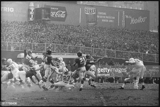 Steve Myra of the Baltimore Colts has a field goal attempt blcked by New York Giants' Sam Huff in first quarter of championship game at Yankee...