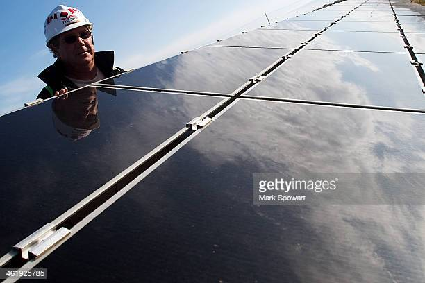 CONTENT] Steve Nagy of First Solar inspects a row of solar cells at the Sarnia Photovoltaic Farm in Sarnia Ontario Canada At the time it was opened...