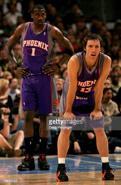 Steve Nash and Amare Stoudemire of the Phoenix Suns await action against the Denver Nuggets as the Nuggets defeated the Suns 131107 at the Pepsi...