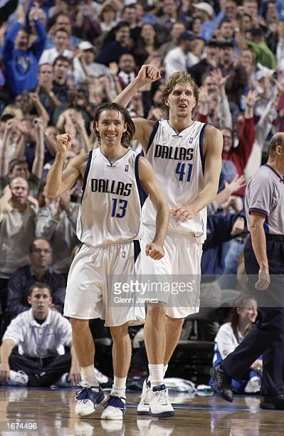 Steve Nash and Dirk Nowitzki of the Dallas Mavericks celebrate during the game against the Seattle Sonics at American Airlines Center on November 23...