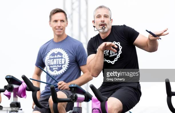 Steve Nash and Michael Stadvec ride at the 6th Annual Tour de Pier at Manhattan Beach Pier on May 20 2018 in Manhattan Beach California