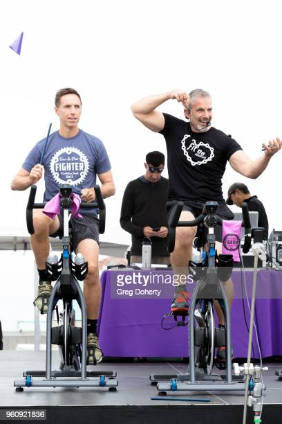 Steve Nash and Michael Stadvec ride on stage at the 6th Annual Tour de Pier at Manhattan Beach Pier on May 20 2018 in Manhattan Beach California