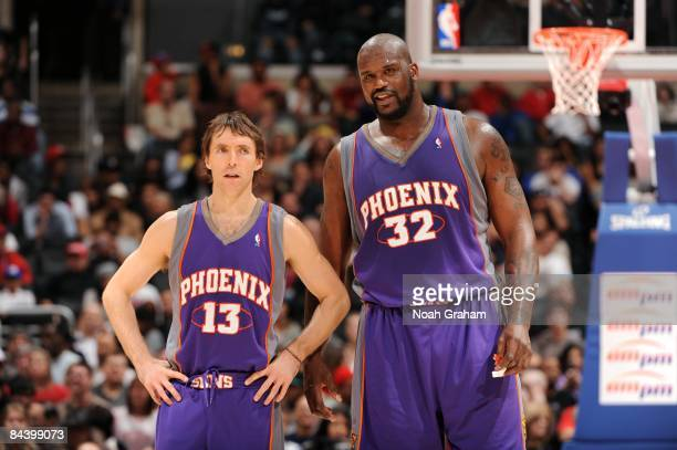 Steve Nash and Shaquille O'Neal of the Phoenix Suns stand on the court during the game against the Los Angeles Clippers at Staples Center on January...
