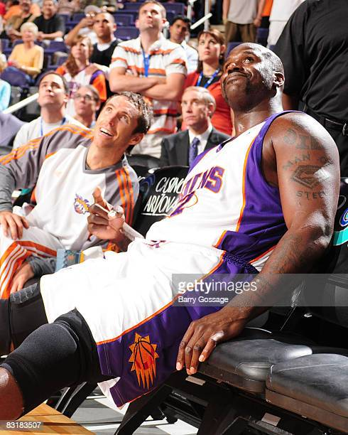Steve Nash and Shaquille O'Neal of the Phoenix Suns watch the pregame festivities on the big screen as the Suns host the Atlanta Hawks in an NBA game...