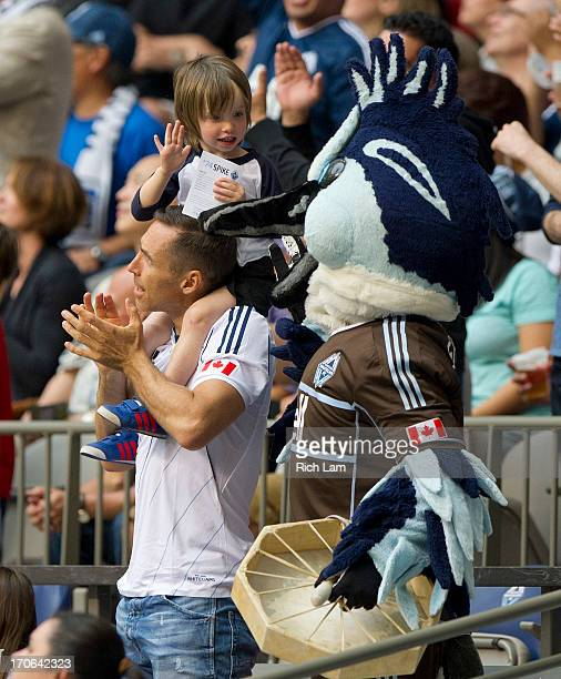 Steve Nash cheers on the the Vancouver Whitecaps during the first half of MLS Soccer against the New England Revolution as his son Matteo Joel high...