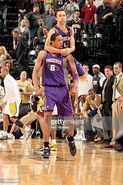 Steve Nash jumps on the back of Channing Frye of the Phoenix Suns after game winning shot in over time against the Indiana Pacers on February 27 2011...