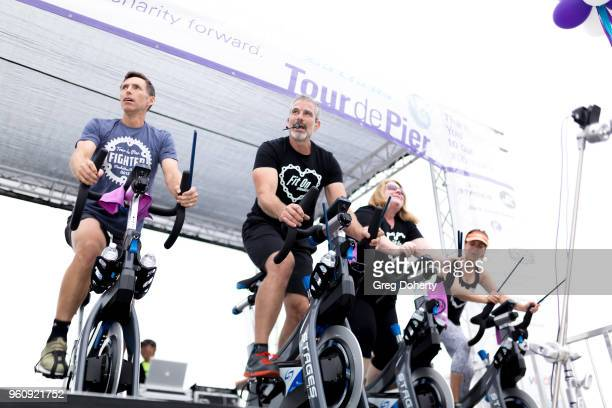 Steve Nash Michael Stadvec Betsy McGloughlin and Franca Stadvec ride on stage at the 6th Annual Tour de Pier at Manhattan Beach Pier on May 20 2018...