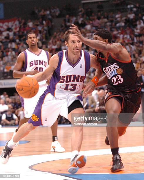 Steve Nash of Phoenix drives past Louis Williams of Philadelphia during the NBA Europe Live Tour presented by EA Sports at the Koeln Arena in...