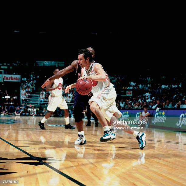 Steve Nash of the Canadian National Team drives to the basket against the United States National Team during a 2000 preOlympic exhibition games on...