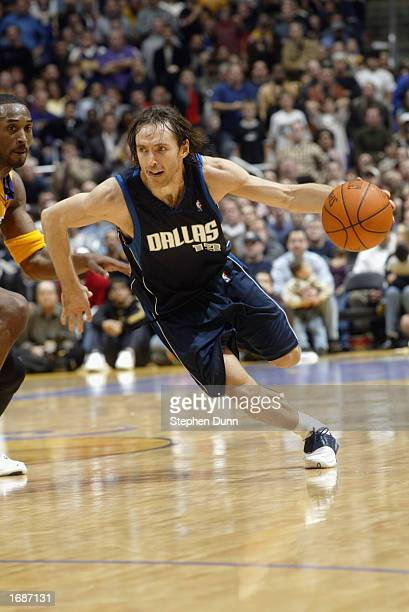 Steve Nash of the Dallas Mavericks drives around Kobe Bryant of the Los Angeles Lakers during the NBA game at the Staples Center on December 6, 2002...