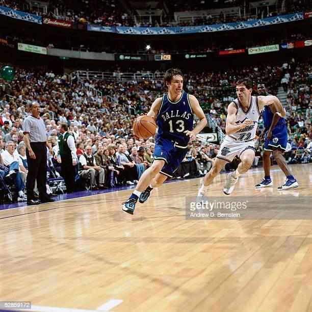 Steve Nash of the Dallas Mavericks drives to the basket against John Stockton of the Utah Jazz during the NBA game circa 2000 in Salt Lake City Utah...