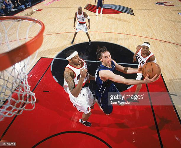 Steve Nash of the Dallas Mavericks goes to the basket against Rasheed Wallave of the Portland Trail Blazers during round one Game 3 at the Rose...