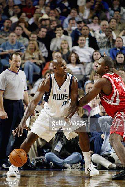 Steve Nash of the Dallas Mavericks is defended by Alton Ford of the Houston Rockets during the game at American Airlines Arena on November 13 2003 in...