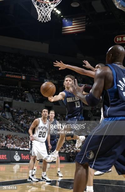 Steve Nash of the Dallas Mavericks makes a pass to teammate Antawn Jamison around Tim Duncan of the San Antonio Spurs while Mano Ginobili watches...