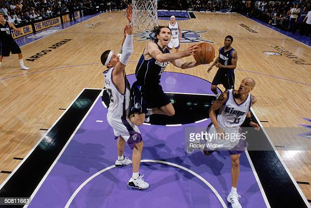 Steve Nash of the Dallas Mavericks shoots a layup over Brad Miller of the Sacramento Kings during Game five of the Western Conference Quarterfinals...