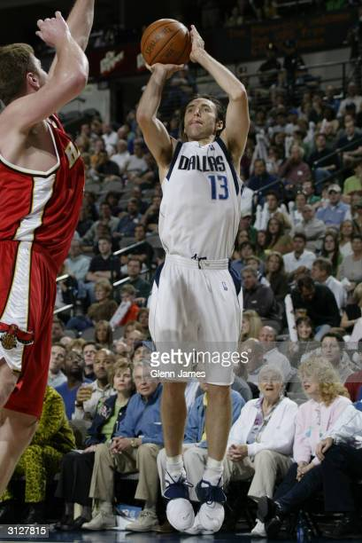 Steve Nash of the Dallas Mavericks shoots over Bob Sura of the Atlanta Hawks during the game at American Airlines Arena on March 17 2004 in Dallas...