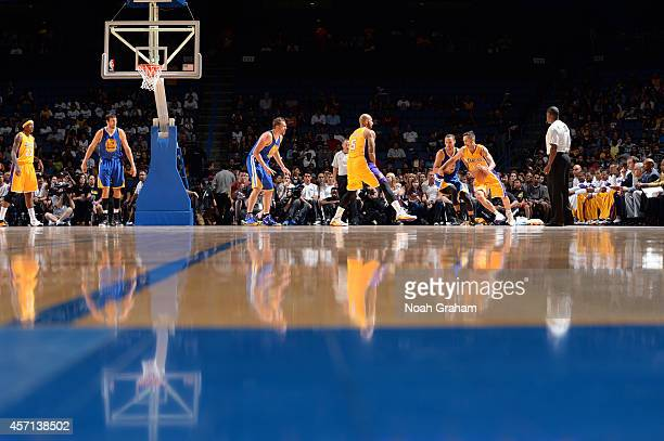 Steve Nash of the Los Angeles Lakers dribbles the ball against Stephen Curry of the Golden State Warriors on October 12 2014 at Citizens Business...