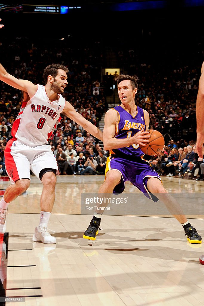 Steve Nash #10 of the Los Angeles Lakers drives against Jose Calderon #8 of the Toronto Raptors on January 20, 2013 at the Air Canada Centre in Toronto, Ontario, Canada.