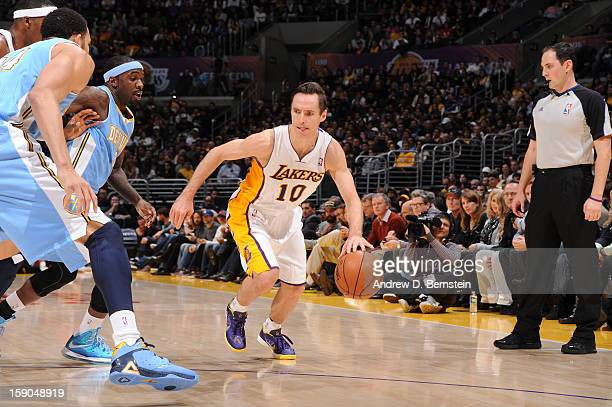 Steve Nash of the Los Angeles Lakers drives against Ty Lawson of the Denver Nuggets at Staples Center on January 6 2013 in Los Angeles California...