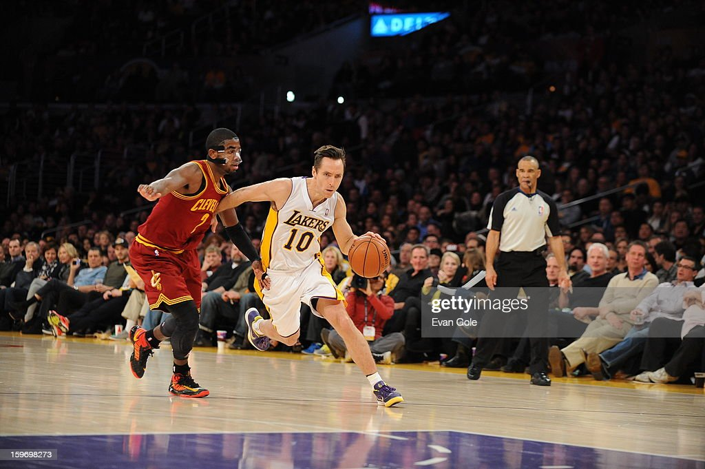 Steve Nash #10 of the Los Angeles Lakers drives to the basket against Kyrie Irving #2 of the Cleveland Cavaliers at Staples Center on January 13, 2013 in Los Angeles, California.