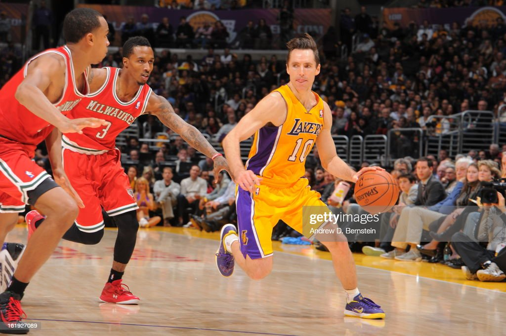 Steve Nash #10 of the Los Angeles Lakers drives to the basket against Brandon Jennings #3 of the Milwaukee Bucks at Staples Center on January 15, 2013 in Los Angeles, California.