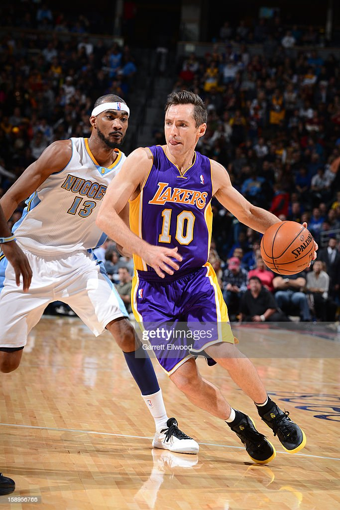 Steve Nash #10 of the Los Angeles Lakers drives to the basket around Corey Brewer #13 of the Denver Nuggets on December 26, 2012 at the Pepsi Center in Denver, Colorado.