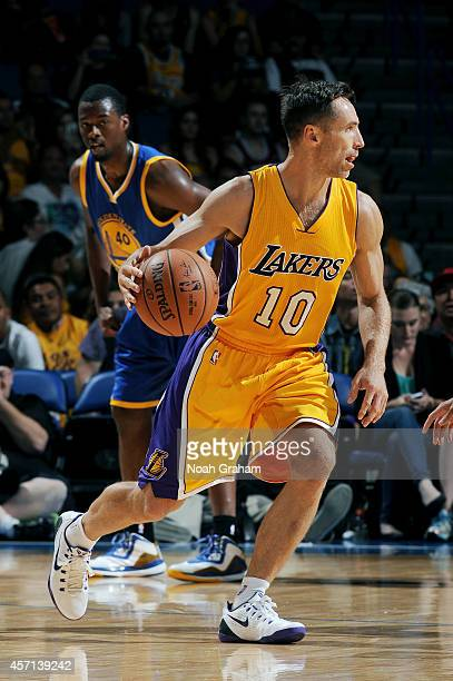 Steve Nash of the Los Angeles Lakers handles the ball during the game against the Golden State Warriors on October 12 2014 at Citizens Business Bank...