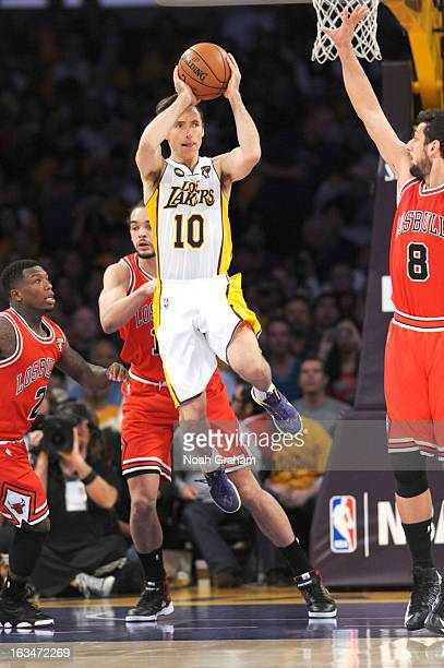 Steve Nash of the Los Angeles Lakers looks to pass against Joakim Noah and Marco Belinelli of the Chicago Bulls at Staples Center on March 10 2013 in...