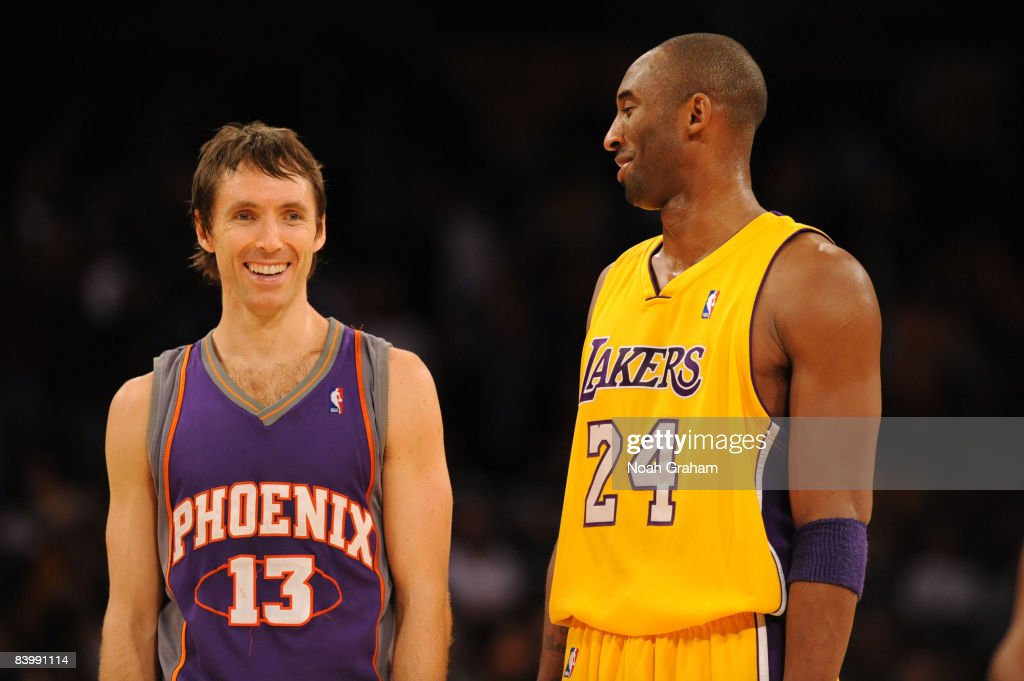 Steve Nash #13 of the Phoenix Suns and Kobe Bryant #24 of the Los Angeles Lakers converse with one another during their game at Staples Center on December 10, 2008 in Los Angeles, California.
