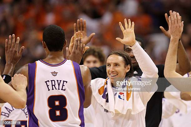 Steve Nash of the Phoenix Suns congratulates teammate Channing Frye after scoring against the Los Angeles Lakers in the second quarter of Game Four...