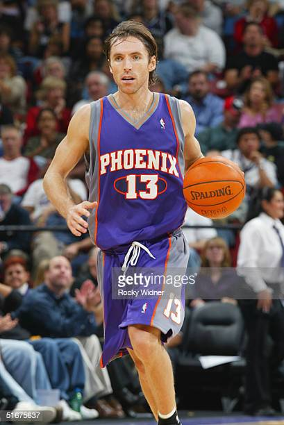 Steve Nash of the Phoenix Suns dribbles the ball upcourt against the Sacramento Kings during the preseason game at Arco Arena on October 29, 2004 in...