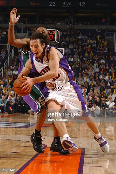 Steve Nash of the Phoenix Suns drives against the Milwaukee Bucks November 24 2004 at America West Arena in Phoenix Arizona NOTE TO USER User...